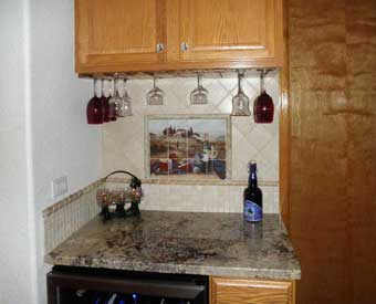This kitchen backsplash project is complete with this wine and vineyard scene tile mural.