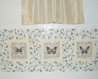 These three tile murals  of butterflies add just the right touch to a bathroom shower wall. The way these tile murals are bordered is ingenious! Great imagination!! Awesome style.