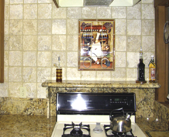 This adorable chef mural by Jennifer Garant  is perfect to liven up this small backsplash space. Notice the mix of ceramic tiles for the mural and stone tiles for the rest of wall. Mix and match it!! It all looks great!