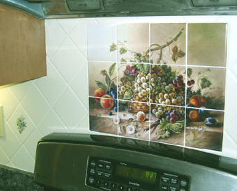This classic painting is  transformed into a beautiful tile mural. This fruit tile mural features a basket of grapes with various fruits surrounding it. This mural is made on satin finish ceramic tiles. Beautiful!