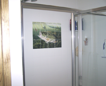 This tile mural of a large mouth  bass really brightens up this shower area. The tile mural brings in color where there the otherwise would have been just a plain white tile wall.