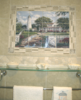 This image of a tile mural  is installed in the bathroom over the towel rack with a glass shelf underneath. Great use of trim tiles to surround the mural. The multiple tile sizes make this tile mural the feature of the bathroom! Great  Imagination!