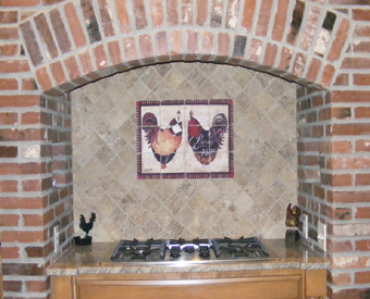 These fancy roosters  are coming to you from Paris. This whimsical rooster artwork by Jennifer Garant is transformed to a tile mural made on tumbled marble tiles. The rustic look of the tumbled marble tiles and brick hearth go  perfectly together.