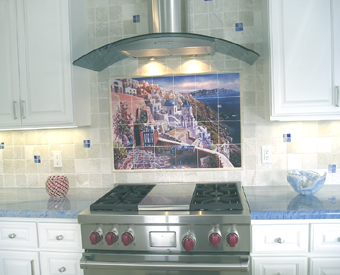 This  gorgeous view of Greece tile mural works wonderfully in this light and bright kitchen. The blues of the tile mural coordinate beautifully with blue countertops. You can enjoy a Greek landscape tile mural  everyday too if you choose the View of Santorini tile mural for your kitchen wall tile.
