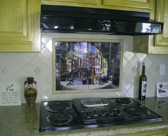 Our Archway to Venice  tile mural is so popular and makes a great kitchen backsplash idea. The variety of colors within this artwork by Sam Park coordinate so well and easily. You can enjoy this Italian scene everyday too by  making the mural yours!