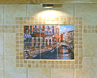A small kitchen backsplash tile mural is  made to look larger by adding a border around the mural. This is a great use of the small mosaic border strip used on the rest of the wall to surround the mural. Here, the smooth surface ceramic tiles that  were used for the mural are mixed with a textured field wall tile. Great contrast!
