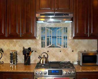 This kitchen backsplash project is complete with this window tile mural.