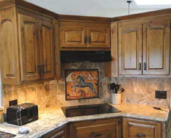 This kitchen backsplash project is complete with this horse tile mural.