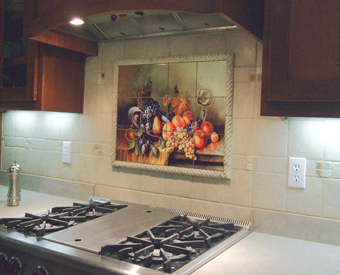 This gorgeous fruit themed tile mural is perfect to use  behind a stove. A classic artpiece, it goes great with the surrounding field tiles. Bordering the mural is a perfect way to let it stand  out and be noticed.