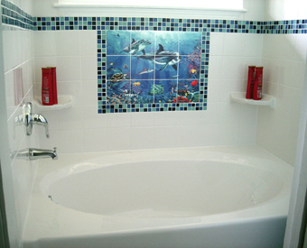 This is a perfect example of how to coordinate your feild  tiles to the tile mural. This client used small mosaic glass tiles to add a decorative border to her area and used the colors from the  mural as a guide. Beautiful design element!