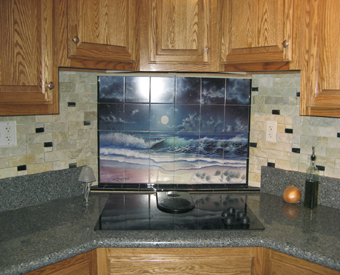 This ocean water view tile mural was custom fit for this  gorgeouse kitchen backsplash. The unique space behind the cooktop looks just GREAT with Dann Spider Warren's Enchanted Waters tile mural!  Water scene tile murals aren't just for Bathrooms!